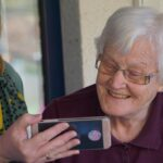 elderly woman using telemedicine apps to talk with her geriatric specialist from her home
