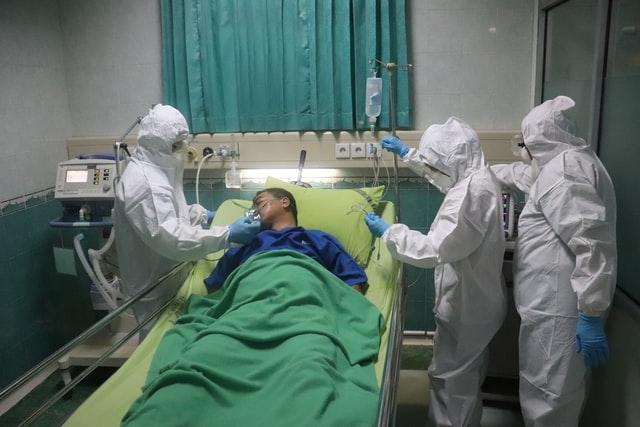 icu patient receiving oxygen treatment for respiratory failure