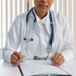 woman doctor prescribing online to a digital pharmacy and telemedicine consult