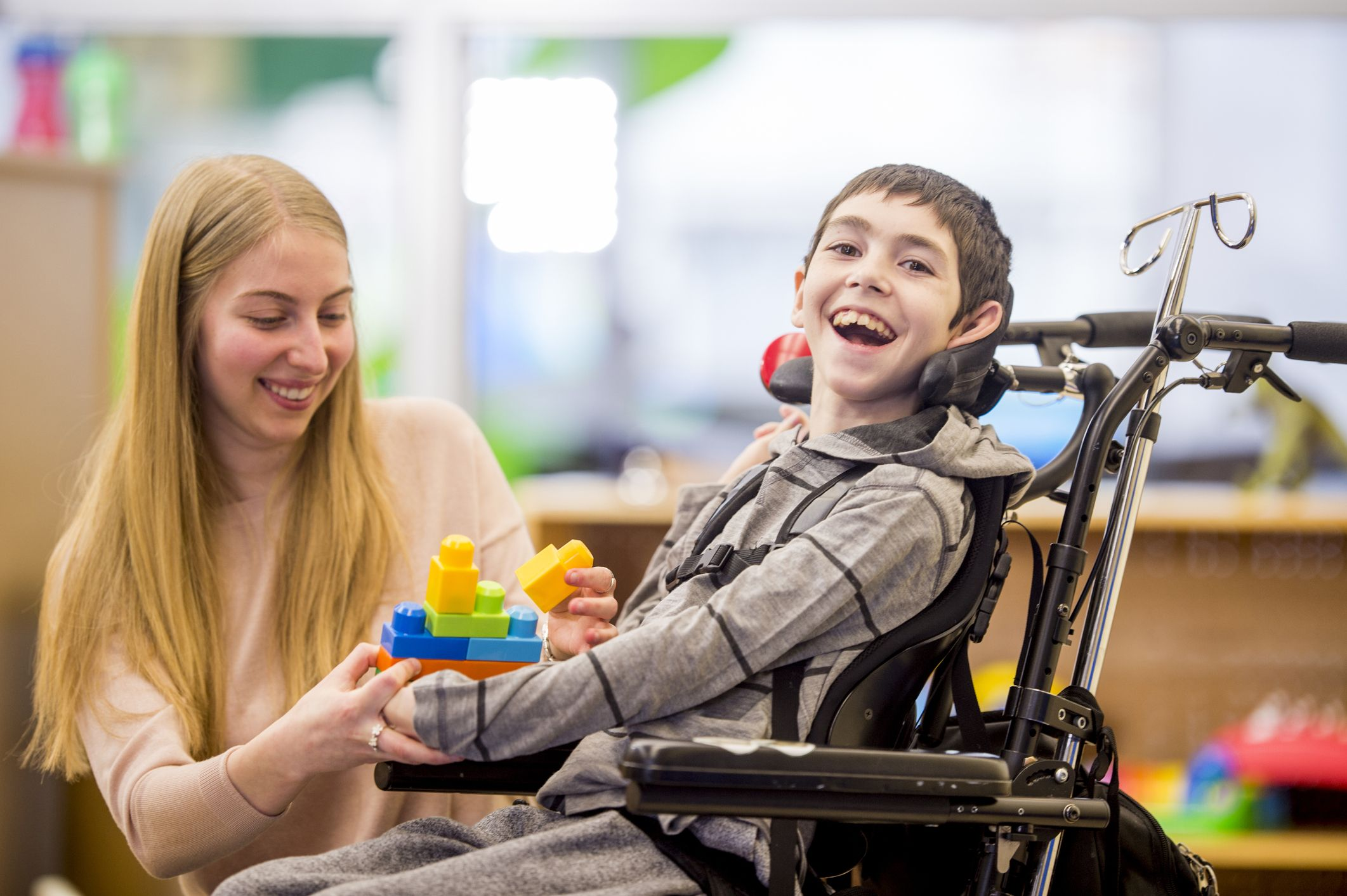 physiotherapist caring for a child with cerebral palsy with help from viosapp