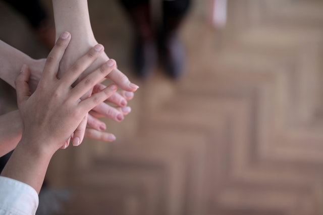family members holding each others hands in support of viosapp