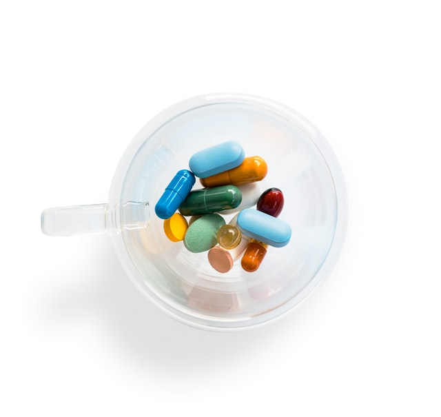 birds eye view of daily medications and pills in a flask