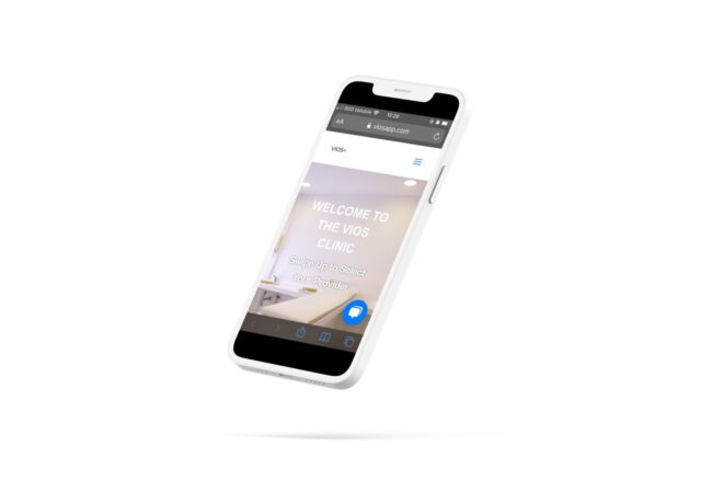 white iphone 11 browsing home page of viosapp clinic for telemedicine booking online